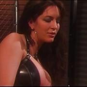 Brunette Mistress spanks her slaves ass