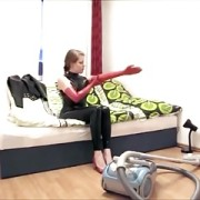 Latex Lady In Long Red Gloves Cleaning House