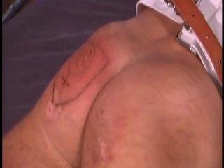 Male slave slowly branded by mistress